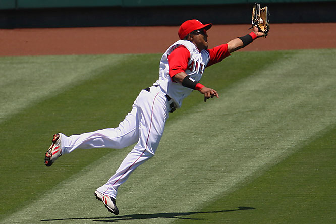 Angels left fielder Erick Aybar makes a diving catch for an out on the Royals' David DeJesus in the fifth inning June 27 at Angel Stadium. Kansas City won 1-0 to sweep the Angels in their three-game series.