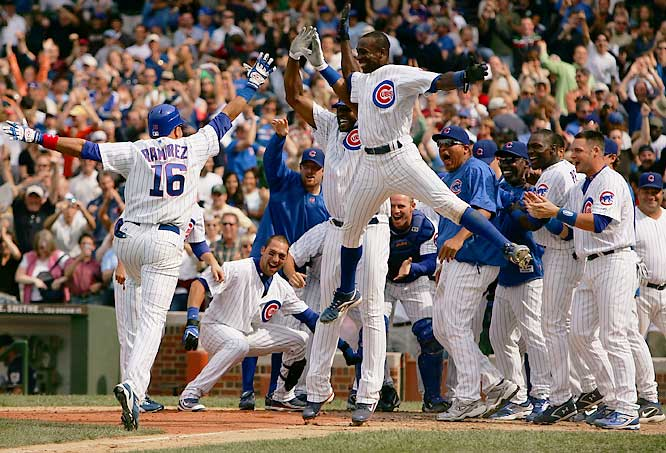 The Cubs' Alfonso Soriano leaps to high-five teammate Aramis Ramirez, who hit a two-out, two-run homer in the bottom of the ninth to beat the Brewers at Wrigley Field on June 29. The Cubs rallied for three in the final inning to win 6-5.