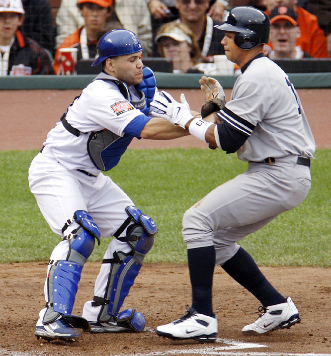 Dodgers catcher Russell Martin tags Yankees third baseman Alex Rodriguez as he tries to score. The out ended the inning and preserved the NL's 1-0 lead.