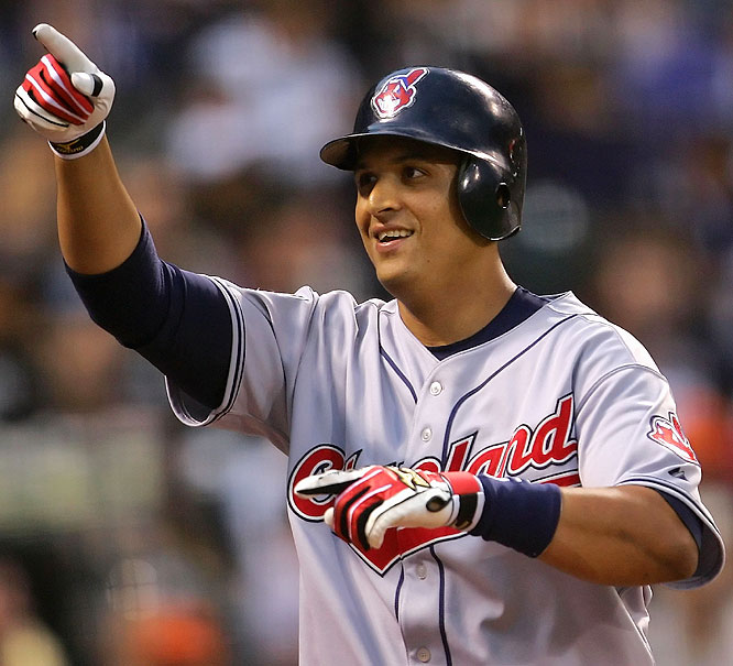 Indians catcher Victor Martinez extended the AL lead to 5-2 with a two-run homer, driving in Boston's Mike Lowell.
