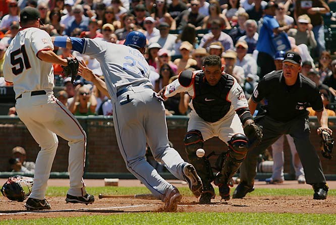 Matt Kemp gets around Giants pitcher Noah Lowry as catcher Bengie Molina tries to field the ball in the fourth inning Sunday at AT&T Park. Kemp scored with a fielding error charged to Lowry as the Dodgers went on to win 5-3.