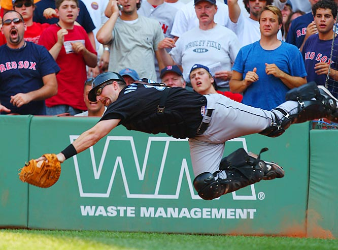 Blue Jays catcher Jason Phillips catches a foul popup by Boston's Mike Lowell in the sixth inning Sunday at Fenway Park. Toronto won 2-1.