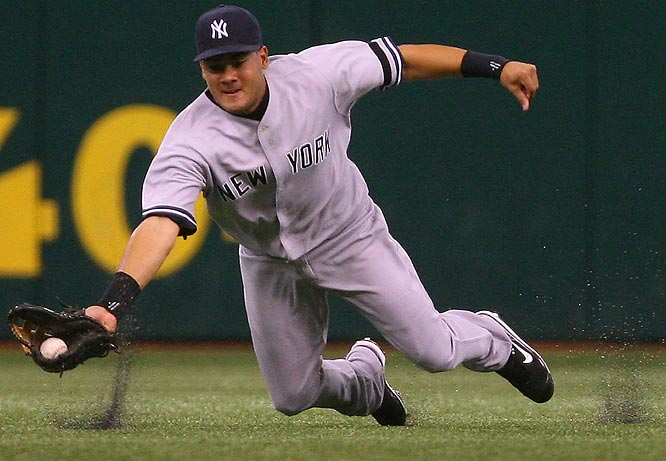 Yankees centerfielder Melky Cabrera makes a diving attempt on a single by the Devil Rays' Akinori Iwamura in the ninth inning Sunday at Tropicana Field. The Yankees won 7-6.