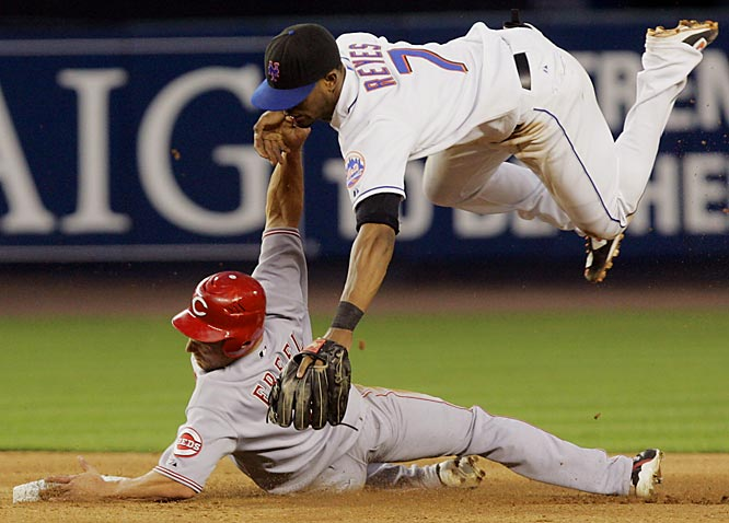 The Reds' Ryan Freel takes out Mets shortstop Jose Reyes while sliding safely into second base in the fifth inning July 13 at Shea Stadium. Cincinnati won 8-4.