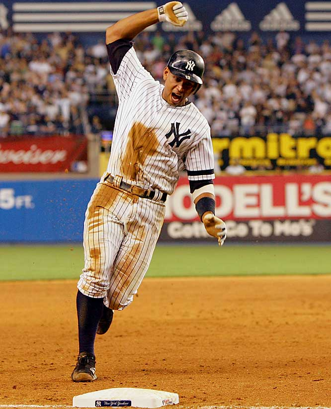 Alex Rodriguez celebrates as he rounds third base and heads home to score the winning run for the Yankees following a base hit by Robinson Cano in the bottom of the 10th inning against the Blue Jays on July 17, at Yankee Stadium. New York won 3-2 and went on to sweep Toronto in their three-game series.