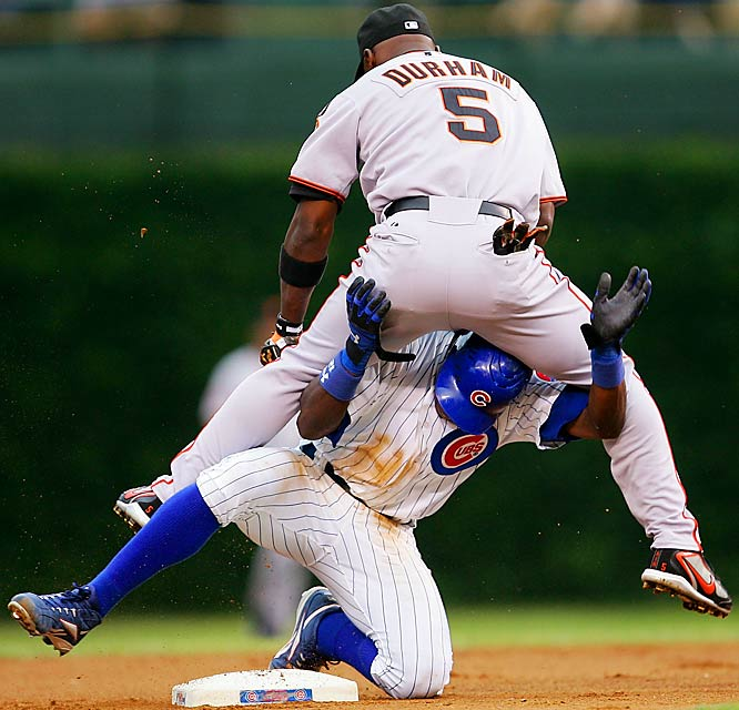 Giants' second baseman Ray Durham lands on top of Alfonso Soriano after turning a double play in the first inning July 16 against the Cubs. Chicago won 3-2.