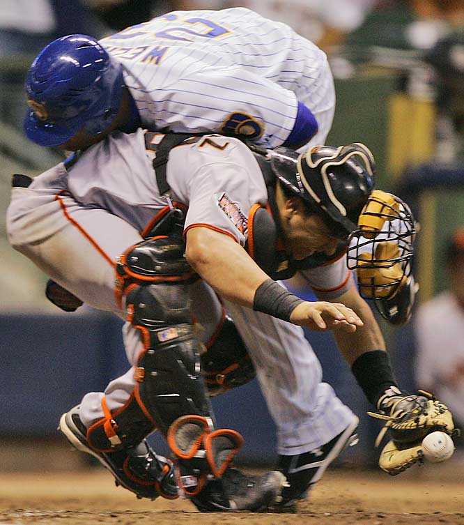 The Brewers' Rickie Weeks collides with Giants catcher Guillermo Rodriguez to score in the fifth inning July 20 in Milwaukee. San Francisco won 8-4.