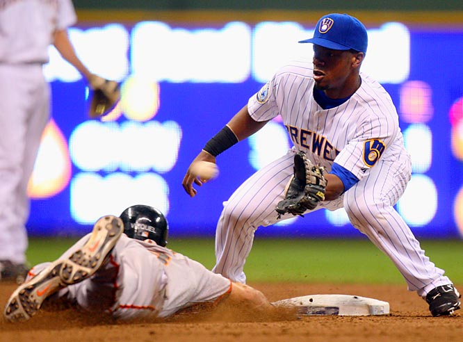 Brewers' second baseman Rickie Weeks fields a throw from catcher Damian Miller as the Giants' Omar Vizquel is caught stealing in the sixth inning Friday, July 20, at Miller Park. San Francisco won 8-4.