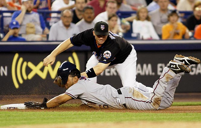D'Angelo Jimenez is tagged out by Mets third baseman David Wright in the fifth inning of the second game of a doubleheader Saturday at Shea Stadium. The Nationals won 6-5.