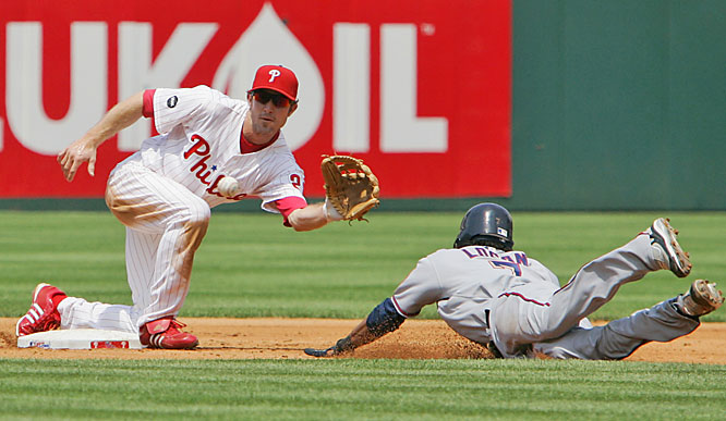 Phillies second baseman Chase Utley catches the Nationals' Nook Logan stealing in the third inning July 26 at Citizens Bank Park in Philadelphia. Despite being hit by a pitch in the fifth inning, Utley finished the game, going 2-for-4. But X-rays taken after the 7-6 loss to Washington showed a broken bone in his right hand.