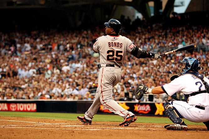 Bonds watching the flight of his 755th career home run.