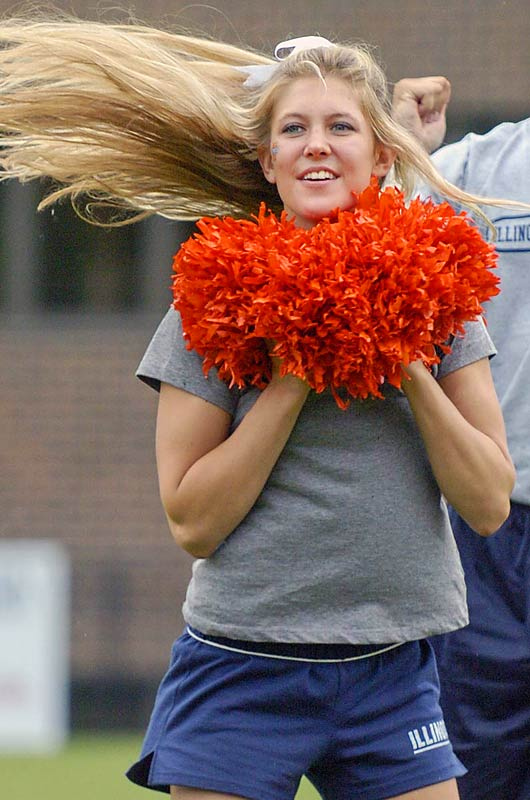 Illinois Fighting Illini sophomore Natalie Keable (and her hair) performs a team sideline cheer.
