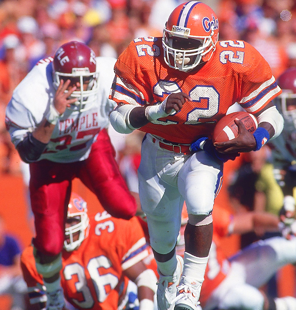 The NFL's career rushing leader's achievements at Florida made him a first-round draft pick and earned him a spot in the College Football Hall of Fame. He finished in the top-ten in Heisman voting in '87 and '89 and was a first team All-American in '89. He gained 1,599 yards as a junior and 3,928 in three seasons.