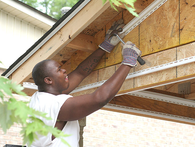 Blue Raiders offensive tackle Franklin Dunbar works on the Habitat for Humanity house.