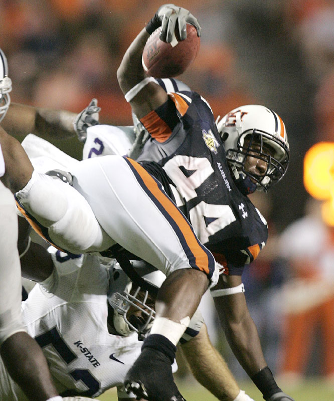 Ben Tate ran for 85 yards as the Tigers survived a scare from Kansas State, scoring 14 fourth-quarter points.