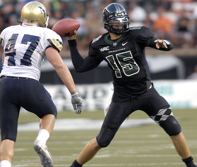 Colt Brennan threw for 416 yards and six touchdowns, setting five school records in the process, as the Warriors rolled.