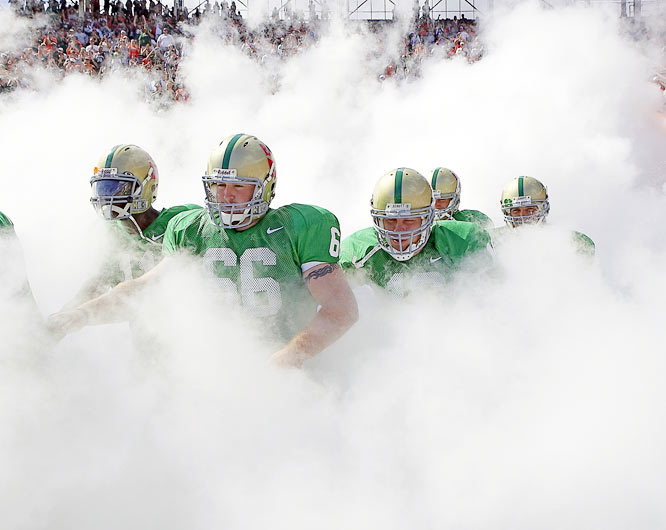 The best thing about college football (other than the action, obviously) is the spirit and enthusiasm that surround the event. This is wonderfully personified when the University of Miami Hurricanes strut their stuff at the beginning of each home game, exiting the tunnel through a cloud of smoke. It sets the tone and makes for a wonderful, ethereal picture.<br><br>Shot with: Canon EOS-1D Mark II, EF 24-70mm f/2.8L USM, shot at 1/1600 f/5.6.