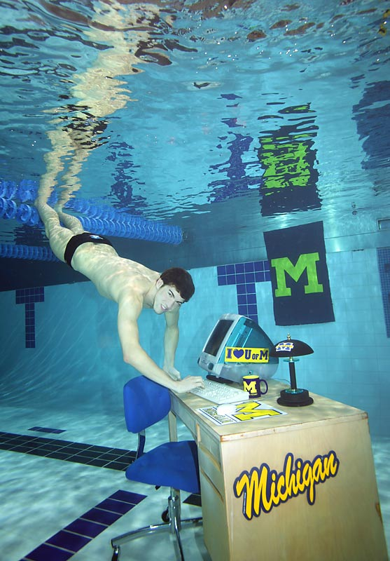 We wanted to create an underwater classroom for Michael, who had just matriculated at the University of Michigan, for an SI On Campus cover. We had a great subject who was totally amused by our efforts, and who could hold his breath for two minutes at a time while I struggled with scuba gear. We lit the setting both above and under the water to get the necessary light. And by the way, that's a real computer underwater.<br><br>Shot with: Canon EOS-1Ds Mark II, EF 20mm f/2.8 USM, shot at 1/200 f/11.