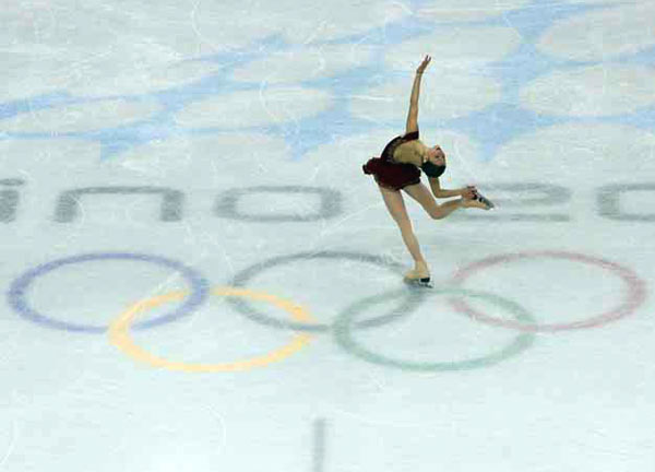 Figure skating is one of the premier events of the Winter Olympics, especially given the glamour and athleticism of the women's competition. Sasha Cohen was no exception when she took the ice for her long program in contention for a gold medal. This scene-setter with the Olympic rings visible was taken from the arena ceiling. I had to place my remote 24 hours in advance, due to security issues. It worked out for a lovely shot.<br><br>Shot with: Canon EOS-1D Mark II, EF 70-200mm f/2.8L IS USM, shot at 1/1000 at f/4