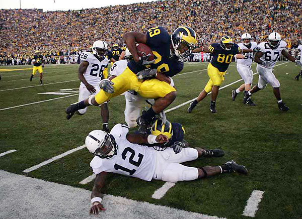 This was surely one of the most exciting college football games I've attended -- a seesaw battle in Ann Arbor, Mich., that ended dramatically with Michigan defeating No. 8 Penn State, 27-25, on the final play. I like the wide-angle look here because it provides a feeling of place, with 100,000-plus fans in Michigan Stadium glued to their seats until the very end. I thought this would run big in the magazine. As it turned out, the Notre Dame-Southern California game down the road in South Bend was, unbelievably, even more exciting. <br><br>Shot with: Canon EOS-1D Mark II, EF 24-70mm f/2.8L USM, shot at 1/1000 at f/4