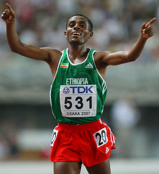 Kenenisa Bekele celebrates after winning the 10,000  on Day 3.