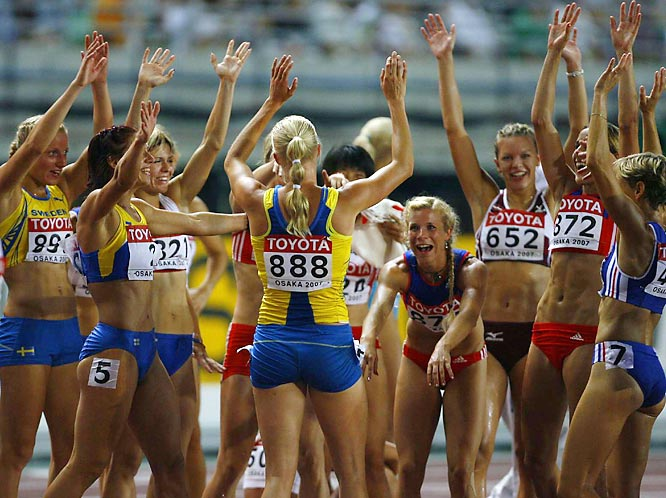 Carolina Kluft (888) of Sweden celebrates her third-place finish in heat 4 of the 800M of the heptathlon.