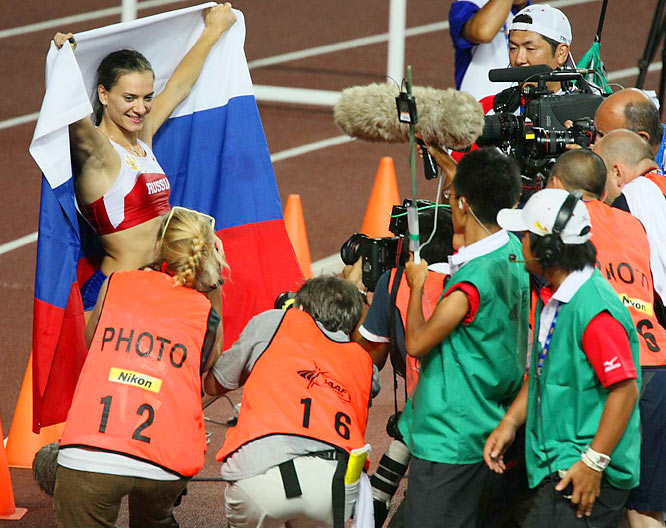 Yelena Isinbayeva celebrates defending her world title in the pole vault.
