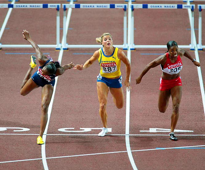 Michelle Perry (left) won her second consecutive world title in the 100-m hurdles, earning another gold for the U.S.
