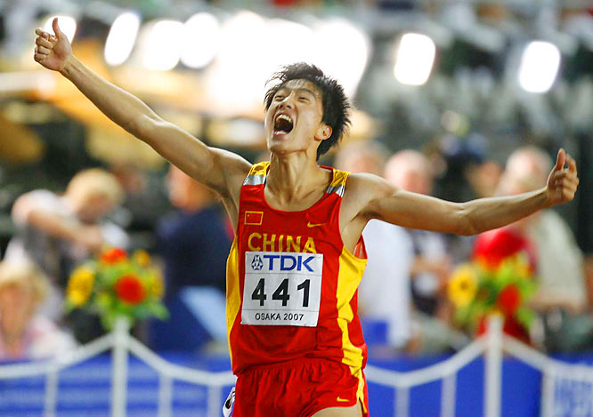 China's most popular athlete,  Liu Xiang, wins the gold in the 110-m hurdles.