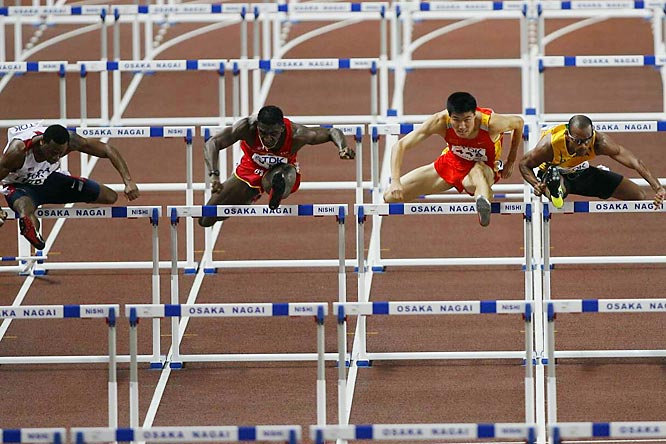Left to right: The American David Payne edged Spain's Jackson Quinonez, China's Dongpeng Shi and Jamaica's Maurice Wignall in the first heat of Men's 110-m hurdles semifinals.