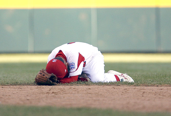 Japanese second baseman Masaya Ogino couldn't bear to watch as Carriker rounded the bases.