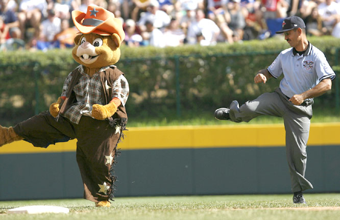 Umpire Donald Escudero took time out during Sunday's action to dance with LLWS mascot Dugout.