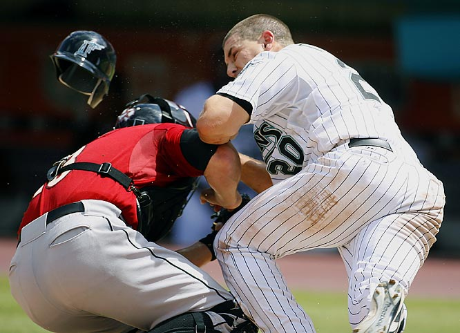 Matt Treanor is out as he collides with Astros catcher Eric Munson in the seventh inning Sunday at Dolphin Stadium. The Marlins won 6-5.