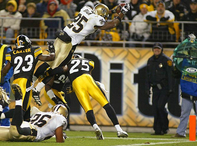 Reggie Bush jumps for a touchdown over Pittsburgh's Ryan Clark, giving the Saints a 17-14 lead, but they ended up losing  38-31.