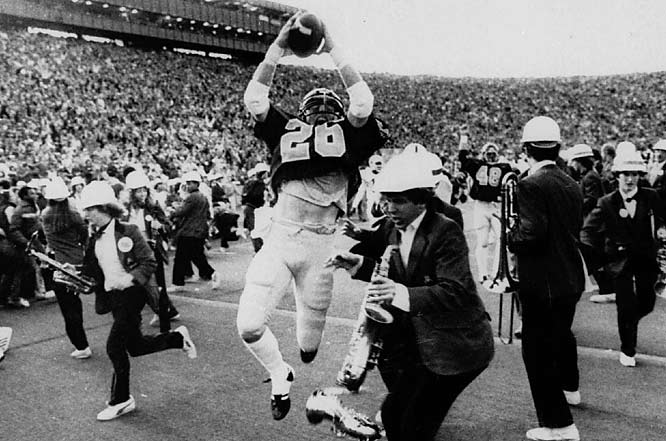 "It is simply known as The Play, the famed last-second, five-lateral kickoff return by Cal on Nov. 20, 1982.  The Play gave the Golden Bears ""the most amazing, sensational, dramatic, heart-rending, exciting, thrilling finish in the history of college football!,"" as Cal announcer Joe Starkey described it. The losing quarterback in the game? A dude named John Elway."