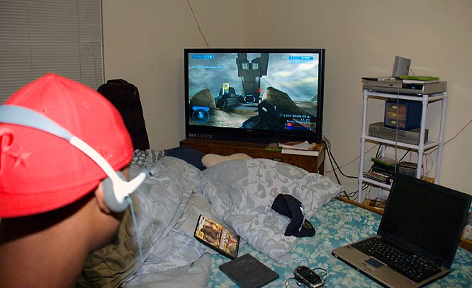 The view from Dre's bed features a widescreen TV used for playing Halo 2 on his X-Box 360. .