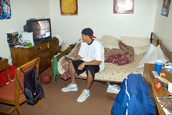 Enter B-Rob's room. Overall, it's fairly typical for a college guy's room. On the wall are a few basketball posters -- one featuring some of today's NBA stars like LeBron and Carmelo, of whose company B-Rob hopes to join in the near future.