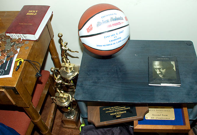 "Instead of boasting his accomplishments in glass cases, B-Rob humbly keeps his trophies, plaques and ""1,000 point club"" ball against the wall on the ground."
