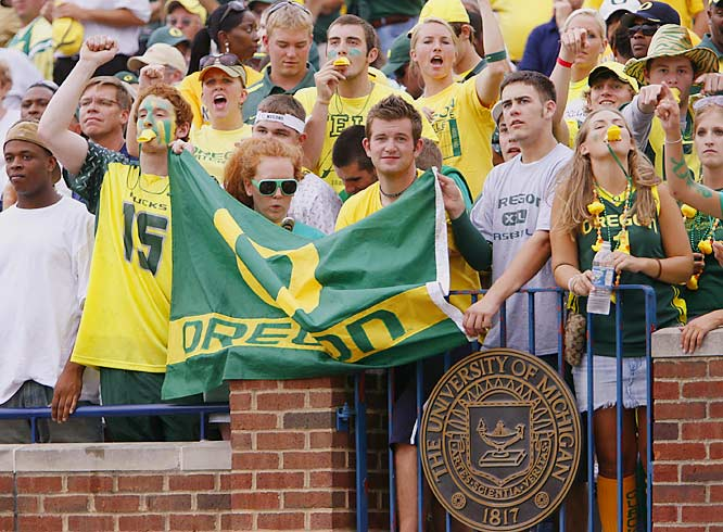 Oregon fans proudly display their team's colors during the Ducks' 39-7 route of the Wolverines at the Big House.