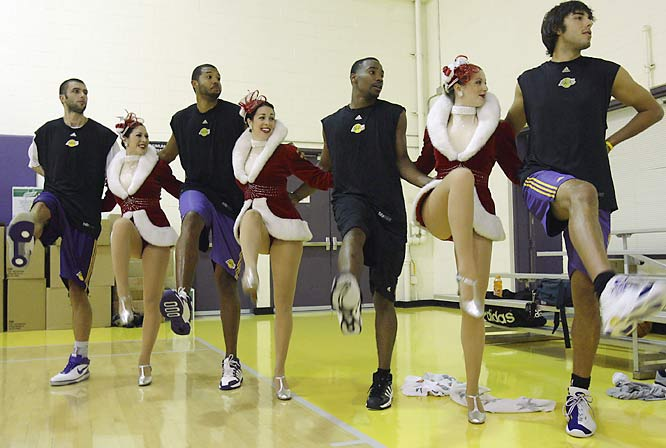 Lakers players, from left to right, Vladimir Radmanovic, Brian Cook, Javaris Crittenton, and Sasha Vujacic are so fed up with Kobe not getting them the ball that they've joined the Rockettes.