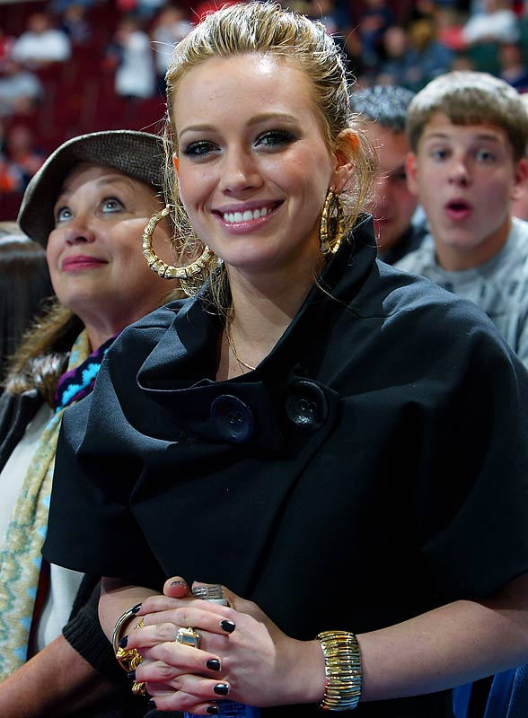 Hilary Duff stays close to boyfriend Mike Comrie by attending this past Monday's preseason game between the Islanders and Rangers.