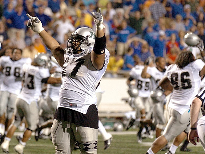 Hawaii's Aaron Kia and the Warriors celebrated wildly when Louisiana Tech's two-point conversion attempt failed in overtime, keeping Hawaii's hopes alive of an undefeated season.