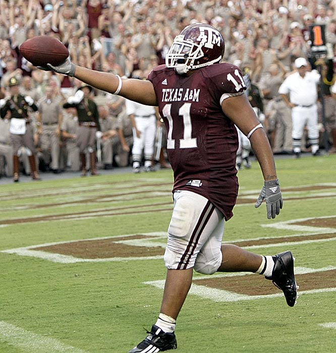 Jorvorskie Lane celebrates his game-winning two-point conversion in the third overtime. Lane bulled his way to four touchdowns on the day for the Aggies.