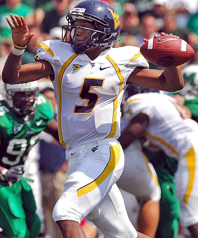Pat White threw two touchdowns and ran for another as WVU rallied from a halftime deficit with 42 second-half points.