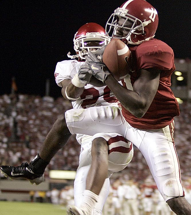 Alabama receiver Matt Cadell catches the game-winning touchdown over Arkansas defender Jamar Love with eight seconds left, sending Bryant-Denny Stadium into a frenzy.