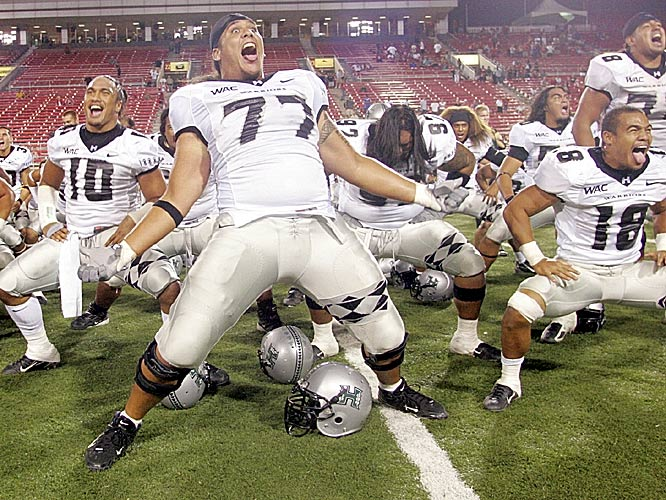 "Hawaii players celebrate their victory over UNLV by performing their controversial ""haka"" dance at Sam Boyd Stadium."