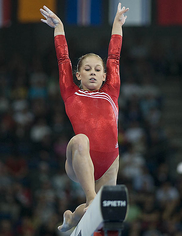 Shawn Johnson's missed a layout on her acro series on the beam, leaving her with a team-low 15.025 in that event.