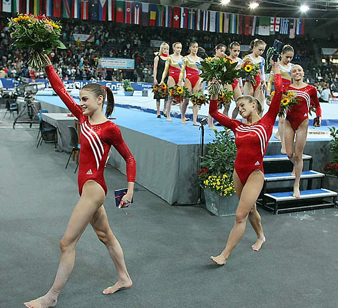 Alicia Sacramone (right) didn't need much more of a reason to dance after her 13.275 score on the mat secured the gold for the U.S.