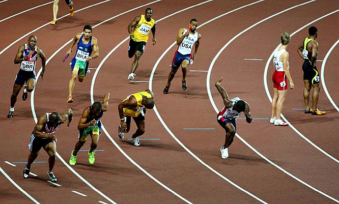 Gay, passing the baton to anchor Leroy Dixon, won his third gold medal in the 4 x 100-meter relay.