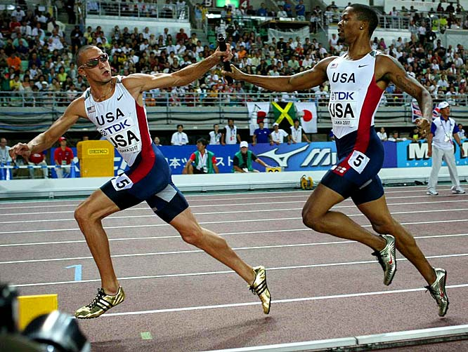 Darold Williamson (handing off) and Jeremy Wariner helped the U.S. 4 x 400-meter team win in 2:55.56.